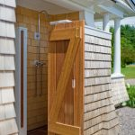 Semi outdoor shower room with wooden door free standing showerhead