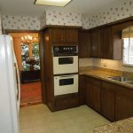 Side By Side Ovens In Kitchen With Wooden Kitchen Set
