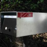 Simple and minimalist metal modern mailbox with black colored door
