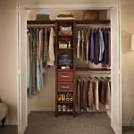 Simple and small closet organizer for clothes with narrow shelves and drawers in the center