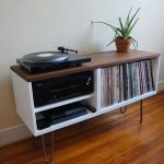 Simple modern vinyl stand idea  with wood top and under shelves for media players and book collection