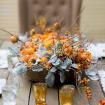 Small Pretty Fall Wedding Center Pieces On Wooden Table