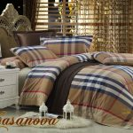 Striped Pattern Bedding With High End Linens And White Side Bed