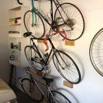 Three series of sport bikes mounted on wooden rack