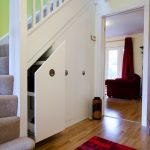 Triple Door Cupboard Under the Stairs With Decorative Red Rug