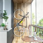 Vertical bike rack idea mounted on wooden wall system