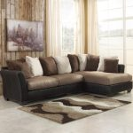 Warm Color Of 2 Piece Sectional Sofa With Chaise With Many Pillows And Small Fur Rug