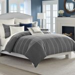 White And Grey Color For Bedding King Size With Large Rug Near Fireplace