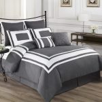 White And Grey Combination Of King Size Bedding With Round Small Side Table