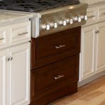 White Kitchen Cabinet With Stove Built In On Marble Countertop