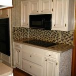 White Kitchen Design With Built In Stove Top