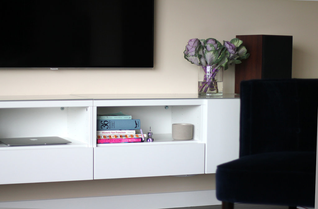 White Minimalist Ikea Media Cabinet With Open Shelves A Large Flat Tv Set Gl Vase