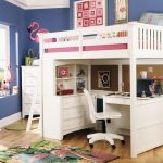 White painted wood loft bed frame IKEA with desk storage and movable chair