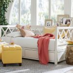 White pottery barn daybed furniture with storage and white bedding idea and also some accent pillows unique shaped side table two units of yellow ottomans