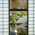 White Shoji Screen Door With Black Painted Wood Frame And Trims
