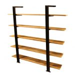 Wood shelves for books with black wrought iron as the supporter