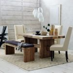 Wooden  Emmerson dining table in square shape a unit of wood bench with black cushion three white modern chairs with higher back white pendant lamp