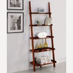 Wooden Leaning Ladder Bookshelf On White Wall Near Frames