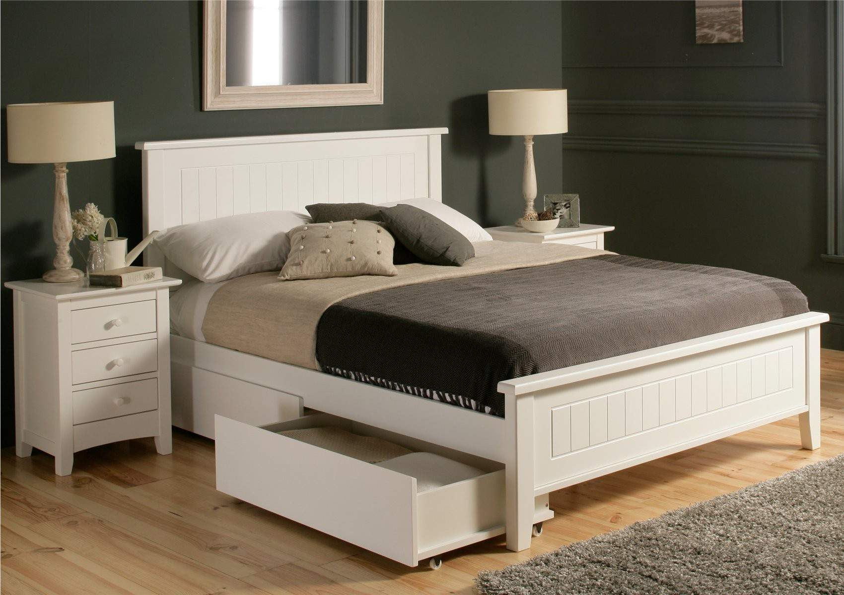 Wooden White Bed With Drawers Underneath And Small Cabinet Standing Lamp Grey Fur Rug