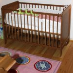 Wooden baby cribs with mattress designed by IKEA