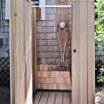 Wooden Outdoor Shower Space In Minimalist Style Presenting Semi Free Standing Showerhead Fixture And Wood Planks Shower Panels And Door And Also Wood Planks Shower Flooring System