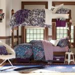 adorabl college dorm room idea with bunk bed for adult and patterned navy blu sheet and comfortable faux sheepskin chair and blue area rug and woodne floor