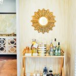 adorable bar cart accessories with golden finished bar cart  arranged with pretty ice bucket and amazing mirror on the wall