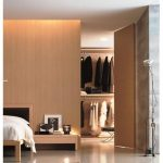 adorable beige dressing room design in the bedroom with beige wooden foor and short nighstand and modern glossy flooring