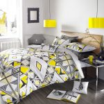 adorable gray and yellow scandinavian bedroom idea with gray bamboo flooring and yellow table lamps and geometrical tribal pattern bedding