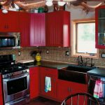 adorable red country kitchen design with patterned tile backsplash and black top and dining space and small glass window