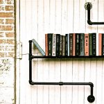 adorable refined black iron hanging bookshelves design on white painted wooden siding aside reddisg brick wall accent