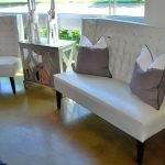 adorable white banquette idea with gray white ombre cushion and black leg and small gray coffee table and painted concrete flooring