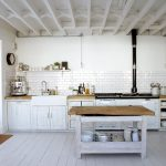 adorable white scandinavian rustic kitchen design with white cbainetry and white brick siding idea and small island design with wooden top and glass window