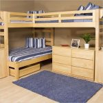 amazing bunk beds with desks plus stripped bedding set and comfy rug and awesome wooden floor