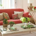 amazing coral colored sofa design with rustic cushion idea aside cross leg end table and white coffee table and glass window