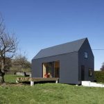 amazing gray small farm house design with extended yard from teh living room with spacious yard with grassy meadow