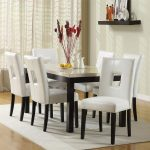 amusing dining room with oxford creek furniture consisting of marble top table and white leather chairs plus white rug and wooden laminate floor and pretty drapes