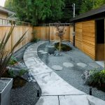 applicable small japanese garden design with concrete patio and sandy mulch and planter box and wooden fence and cottage