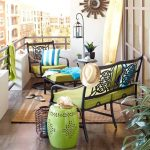 awesome apartment balcony furniture made of wrought iron and green upholstery and unique end table and attractive jute rug plus green coffee table