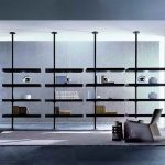 awesome-decorative-black-shelving-unit-idea-for-books-and-stuffs-with-gray-and-white-wall-and-also-gray-floor-tile-with-white-rug-and-a-reading-chair-decorate-with-pendant-lamps
