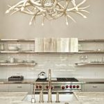 awesome white antler chandelier with kitchen sink above plus modern faucet and subway back splash tile