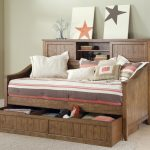 awesome wooden daybeds with storage beneath plus striped bedding and fun cushions plus headboard with storage and decorative accessories plus jute rug