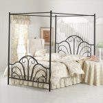 beautiful iron canopy bed frame with girly bedding set plus comfy white chairs plus round night table adorned with table cloth plus pretty table lamp