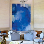 best interior painting idea in blue color on creamy wall with soft blue sofa design and beige accent and glass table