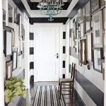 best narrow corridor design idea with wall pictures exhibition and gray white paint decoration and runner rug and chair and chandelier and white wooden door