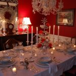 best red and white christmas centerpiece with table ware and acriyc candle holder and chandelier and table lamps and wall picture