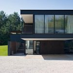 black and minimalist two storey house dsign with open concept and white sheer curtain and basement and grassy meadow