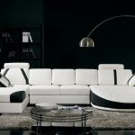 black and white living room ideas with white and black leather sofa and furry rug plus black wooden bookcase and curved floor lamp