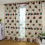 blackout curtains nursery with cartoon motif and cartoon shades plus white cabinets and wooden laminate floor