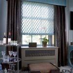 blue contemporary window valances combined with brown curtain and shades plus wooden sideboard plus bar cart and tartan carpet